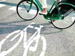 L'Aquila: una rotaia, una bici e una città