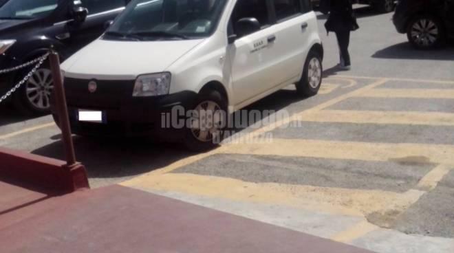 parcheggio auto comune posti disabili