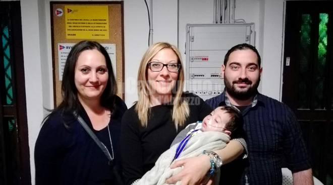 volontario del sisma con figlio malato